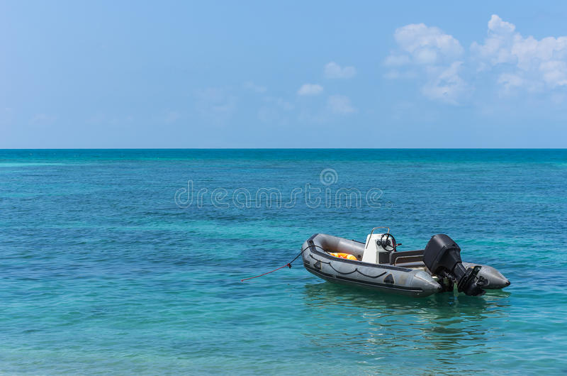 Inflatable boat. Moored at the coast clear, Chonburi, Thailand stock photography