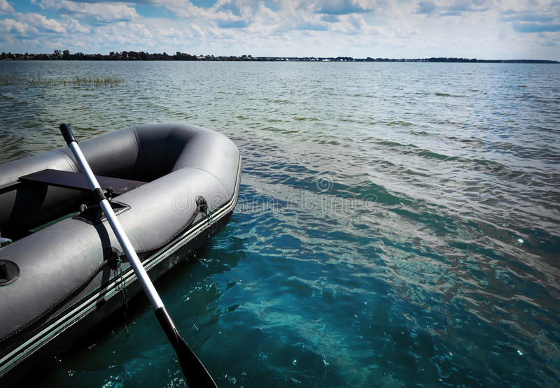 Inflatable boat with a motor. On a beautiful picturesque lake. the boat left right copy space royalty free stock photography