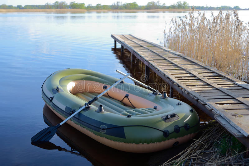 Inflatable boat. At the river berth stock photo