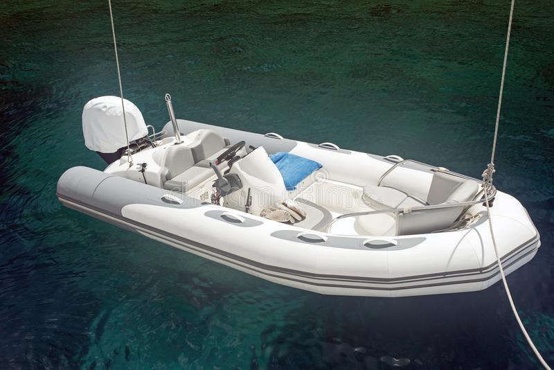 An inflatable boat on the super clean and clear Aegean sea.  royalty free stock photography
