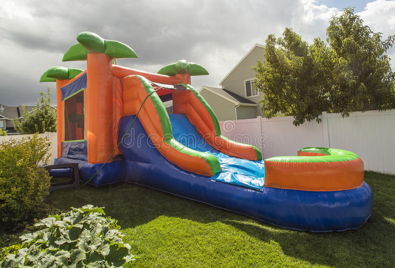 Inflatable Bounce House Water Slide In The Backyard Stock ...