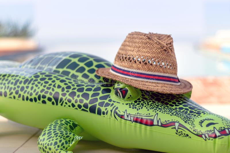 Inflatable Crocodile with Straw Hat stock images