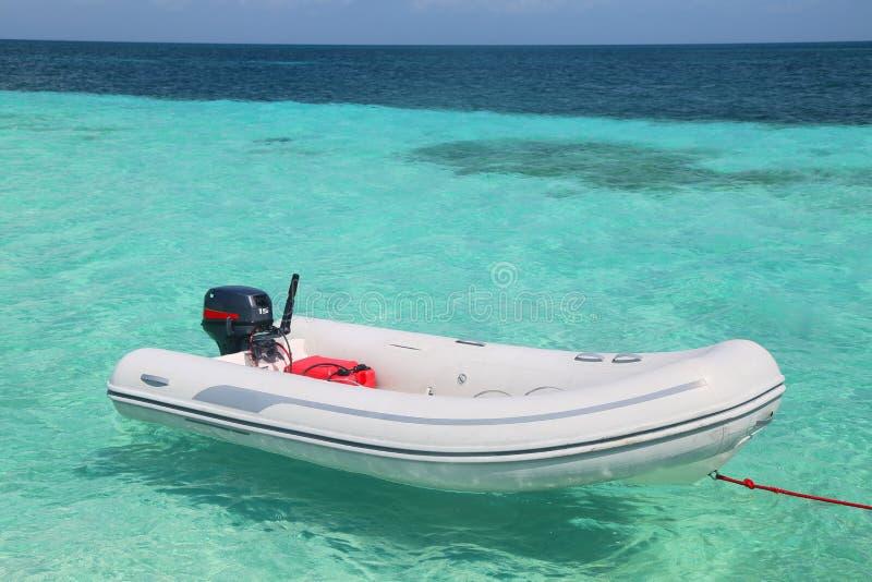 Inflatable dinghy. Near yacht at Caribbean sea stock photography