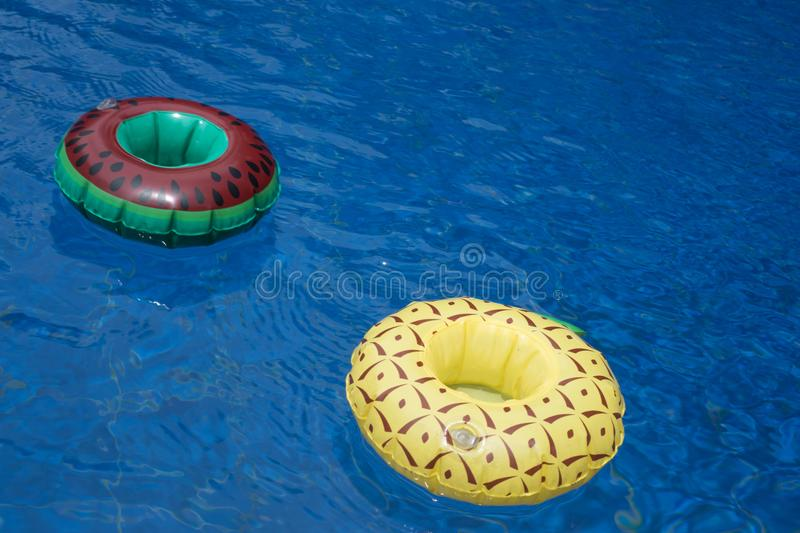 Inflatable drink holders in the pool stock photography