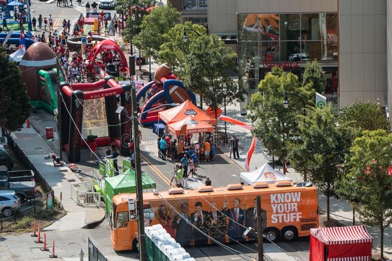 Inflatable Games Set Up Along Street At College Football Festival royalty free stock image