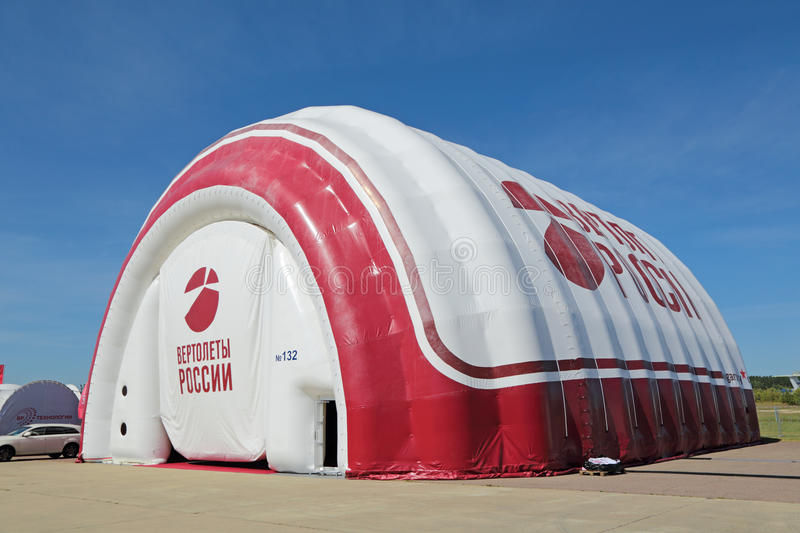 Inflatable hangar. ZHUKOVSKY, MOSCOW REGION, RUSSIA - AUG 24, 2015: Inflatable hangar for the helicopters at the International Aviation and Space salon MAKS-2015 royalty free stock images