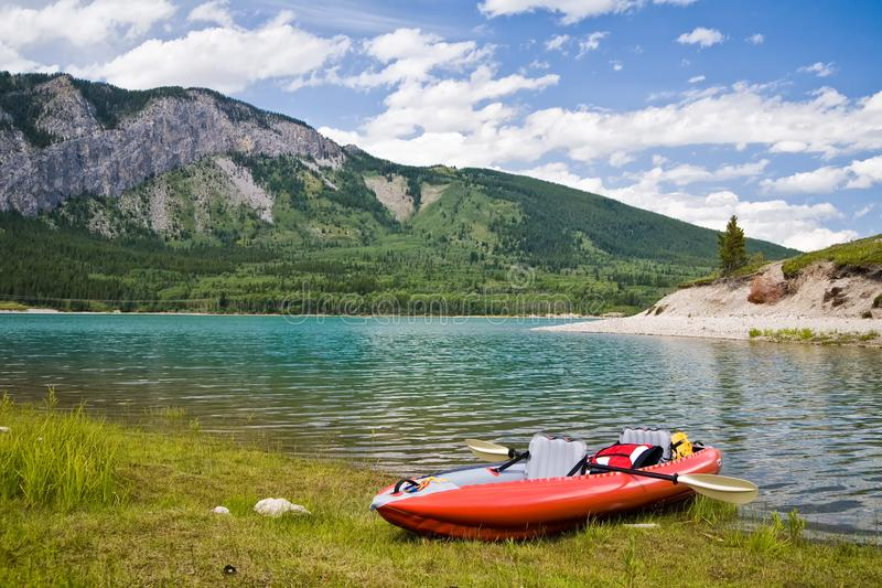 An inflatable kayak on a lake in the mountains stock image