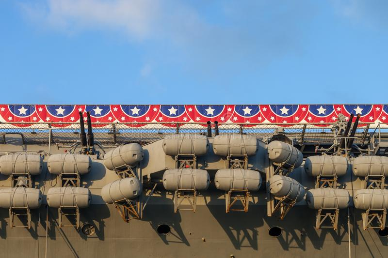 Inflatable lifeboat capsules on a retired aircraft carrier ship royalty free stock photography