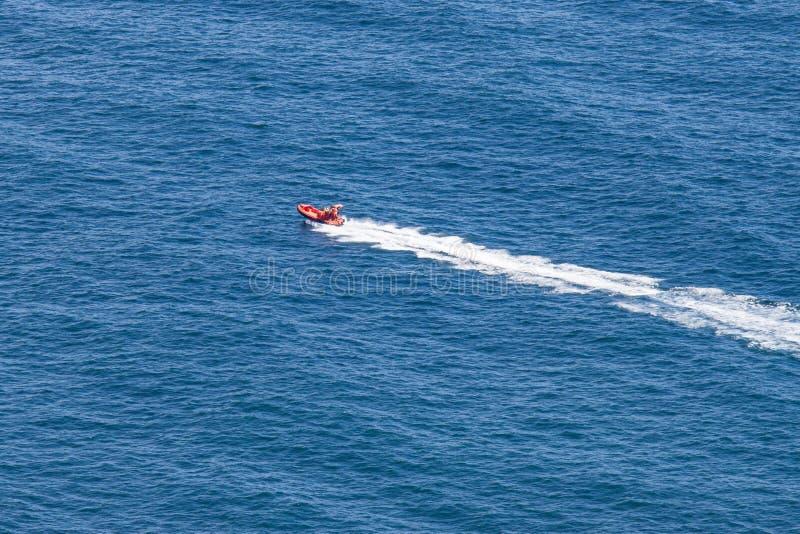 Inflatable Orange Boat On Blue Ocean in Newfoundland stock image