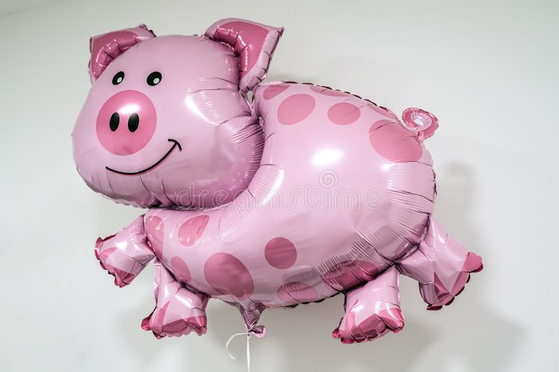 Inflatable pig shaped helium balloon on string white background lucky luck theme royalty free stock images