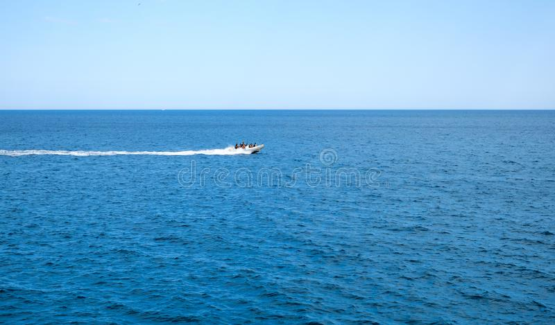 Inflatable rib boat cruising in high speed stock photos