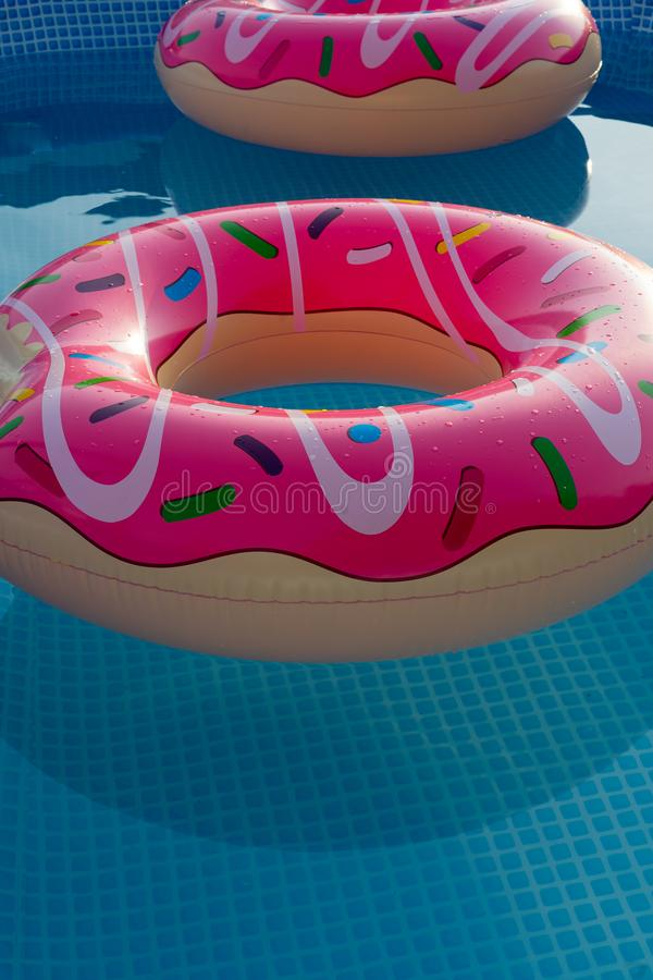 Inflatable rings in house swimming pool for children royalty free stock image