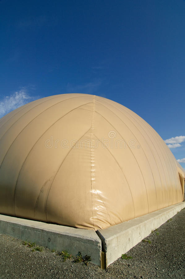 Inflatable Soccer Dome. A modern soccer dome in the suburbs. The dome is erected in a single day on top of a concrete foundation royalty free stock image