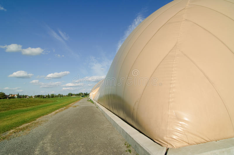 Inflatable Soccer Dome. A modern soccer dome in the suburbs. The dome is erected in a single day on top of a concrete foundation stock image