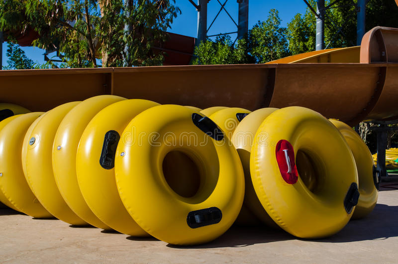 Inflatable wheels for high-speed descent in the water park royalty free stock photo