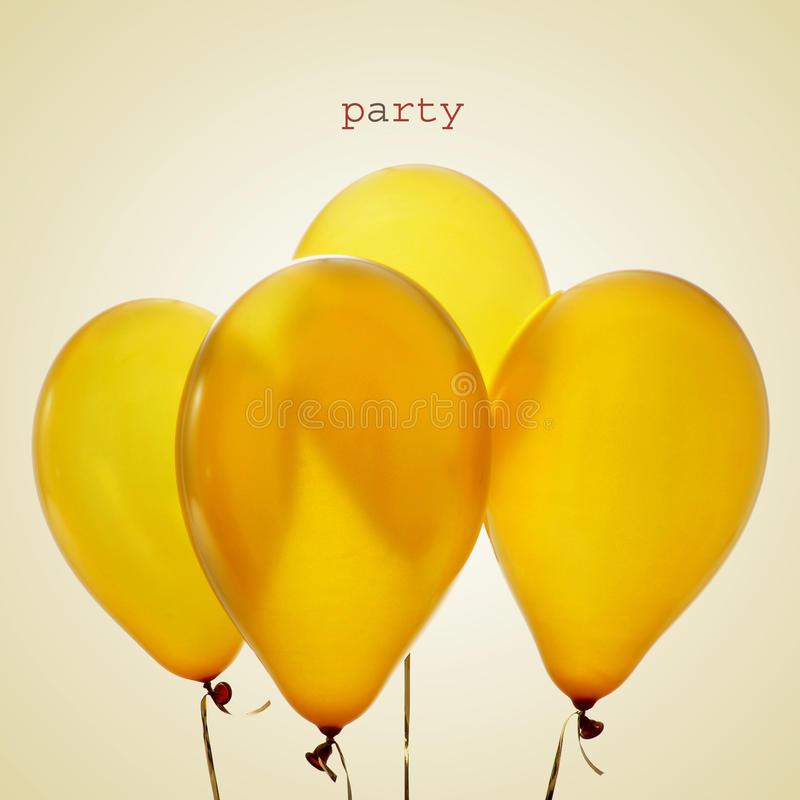 Inflated golden balloons and word party, with a retro effect stock image