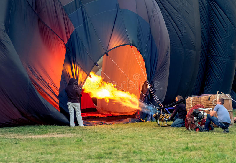 Inflating hot air balloon burner stock image
