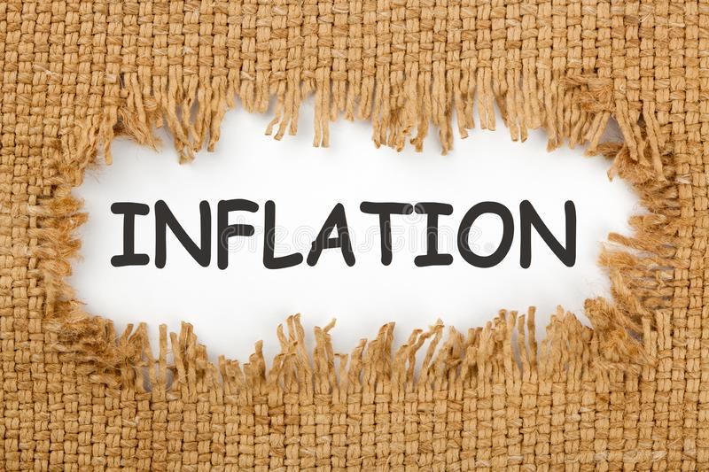 Inflation Written In Hole On The Burlap. Piece of burlap with hole with the word inflation. Business concept royalty free stock photos