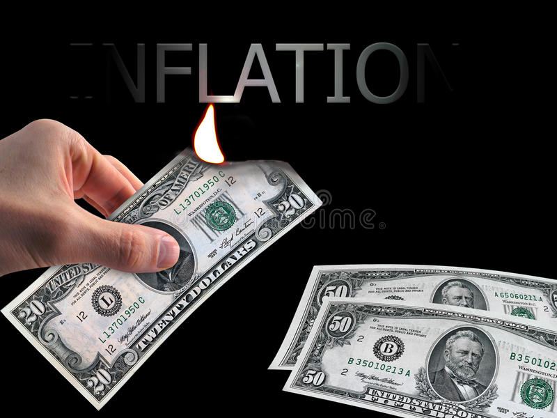 Inflation in the light of the burning dollar royalty free stock image
