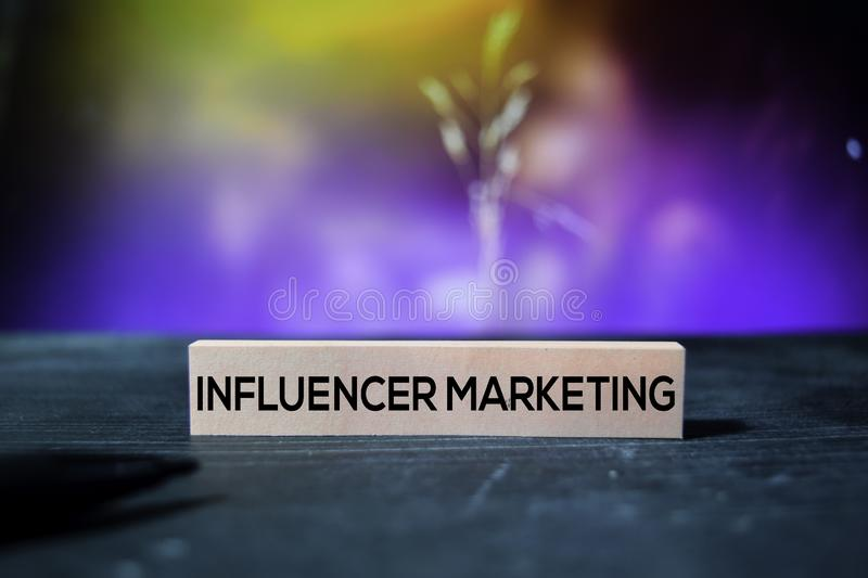 Influencer Marketing on the sticky notes with bokeh background stock photo