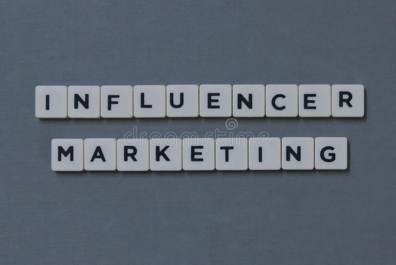 ' Influencer Marketing ' word made of square letter word on grey background. Digital, business, concept, technology, communication, internet, online stock photography