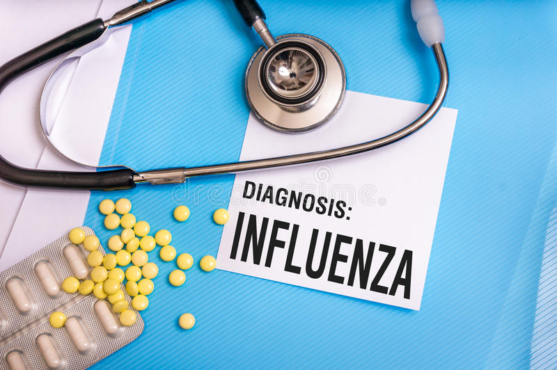 Influenza word written on medical blue folder with patient files royalty free stock photos
