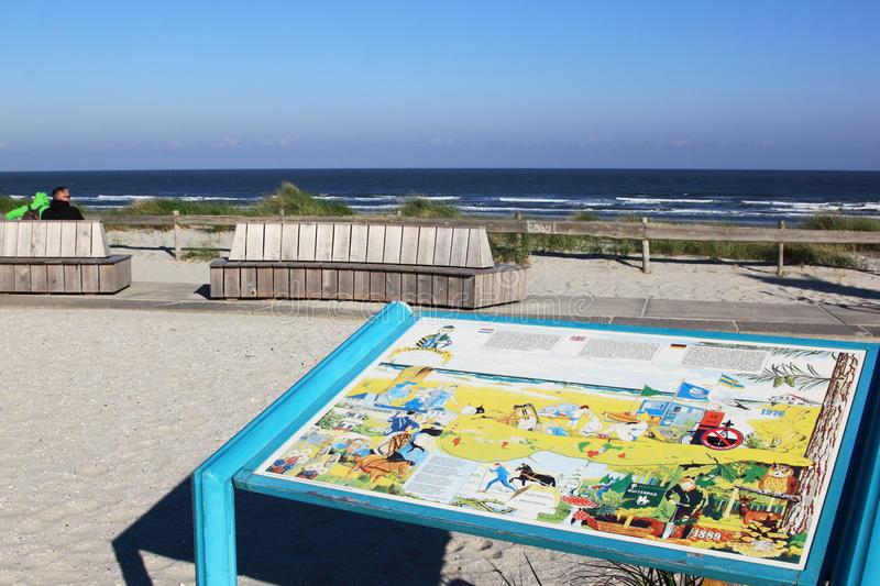 Info table in dunes at Ameland Island, Holland. Ameland is one of the West Frisian Islands off the north coast of the Netherlands. It consists mostly of sand royalty free stock photos