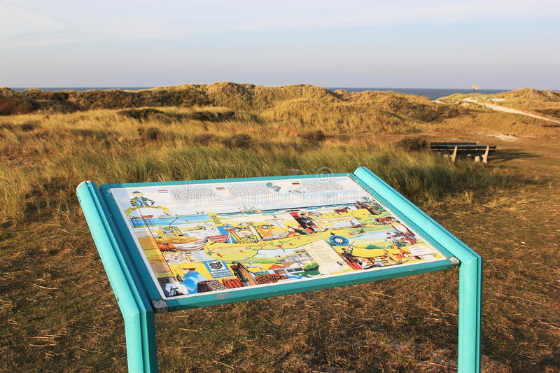 Info table in dunes (Bureblinkert) at Ameland Island. Ameland is one of the West Frisian Islands off the north coast of the Netherlands. It consists mostly of stock photos