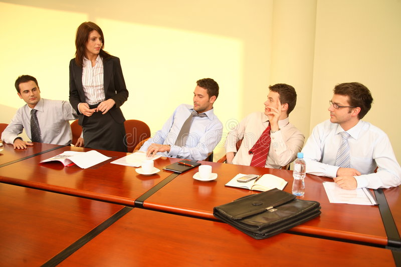 Informal business meeting - woman boss speech. Informal business meeting of five persons - standing woman boss speech stock photos