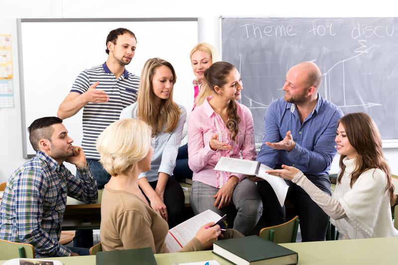 Informal discussion between teacher and students stock images