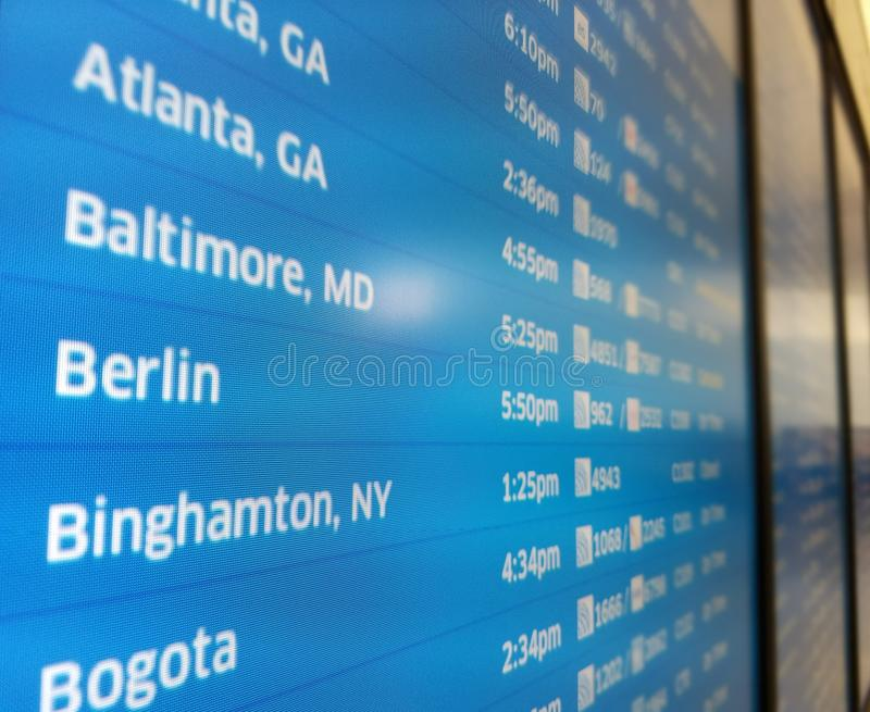 Information board. The airport terminal board displays information for departures and arrivals. This style and color of information board is common on airports stock image