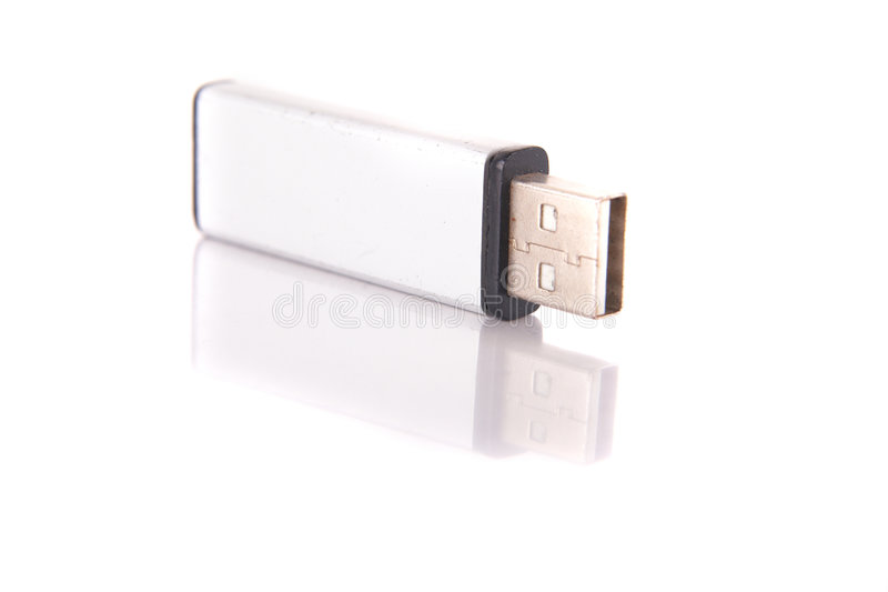 Information carrier. Isolated shot of a silver USB stick. The stick is mirrored and isolated over pure white. Lot of copyspace stock photos