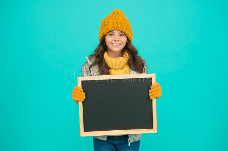 Information for children. Happy holidays. Show information. Winter entertainment and activities. Presentation concept. Smiling girl wear winter outfit blank royalty free stock photos