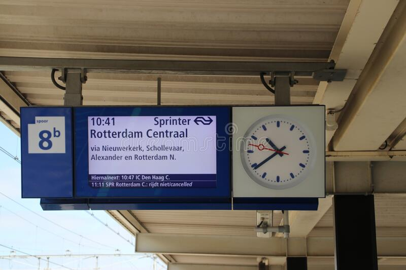 Information display at platform of Gouda Station in the Netherlands with travel information for train heading to Rotterdam stock image