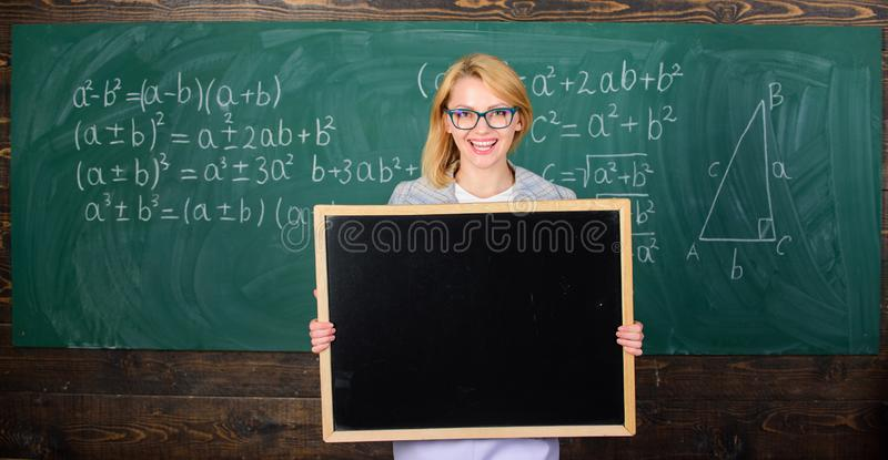 Information for incoming exchange students. Teacher show school advertisement. Place for school advertisement. Official stock photos
