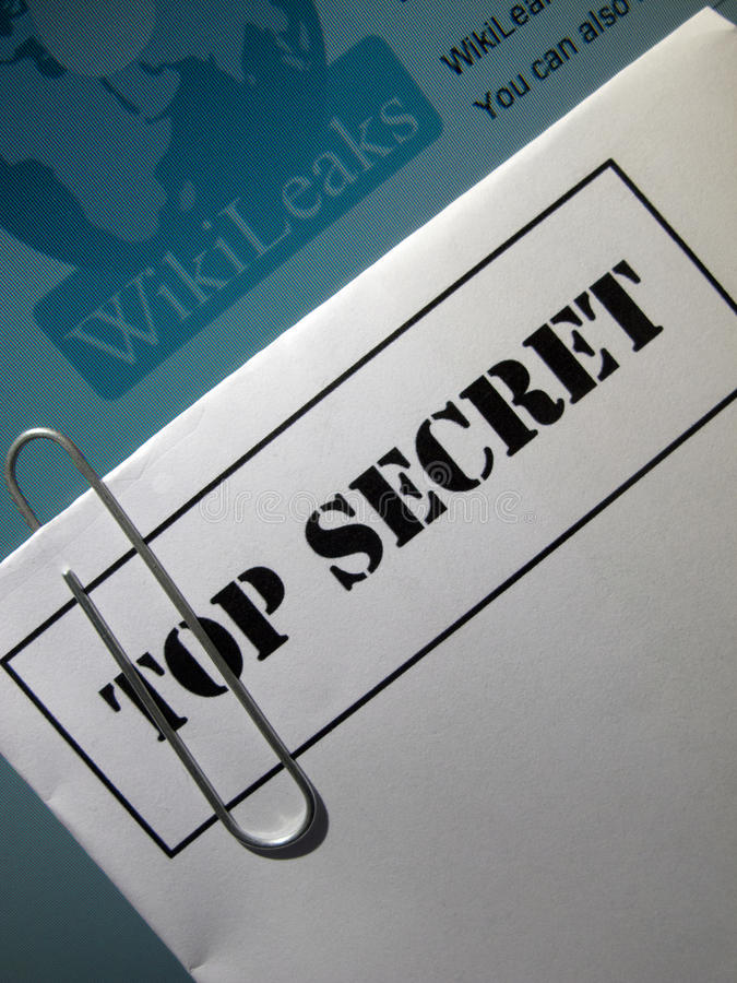 Information leak. A top secret envelope on top of wikileaks logo on a computer monitor royalty free stock photos