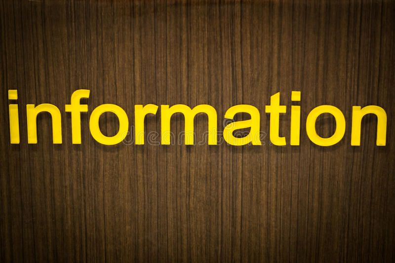 Information letter sign or label on wooden wall royalty free stock photo