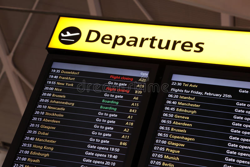 information om flygplatsflyg arkivfoto