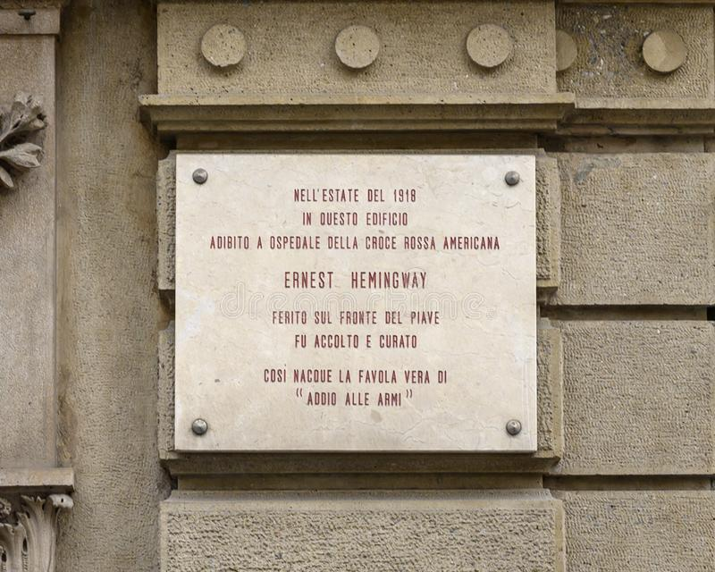 Information plaque for the building used as a hospital of the American Red Cross where Ernest Hemingway was treated for war wounds stock photography