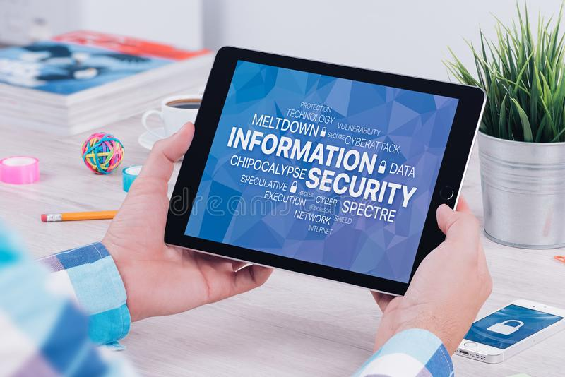 Information security concept on digital tablet pc in male hands stock photo