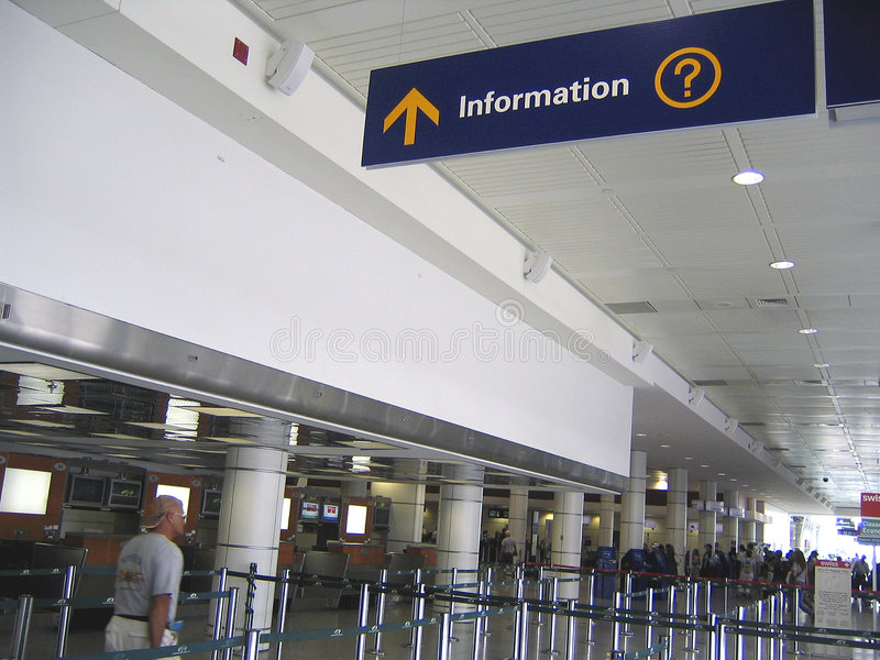 Information sign and baggage checking at airport stock photo