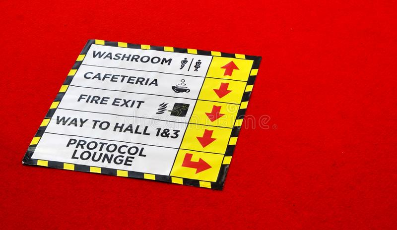 information sign sticker regarding ways  to  various places on the floor in an expo,trade show stock images