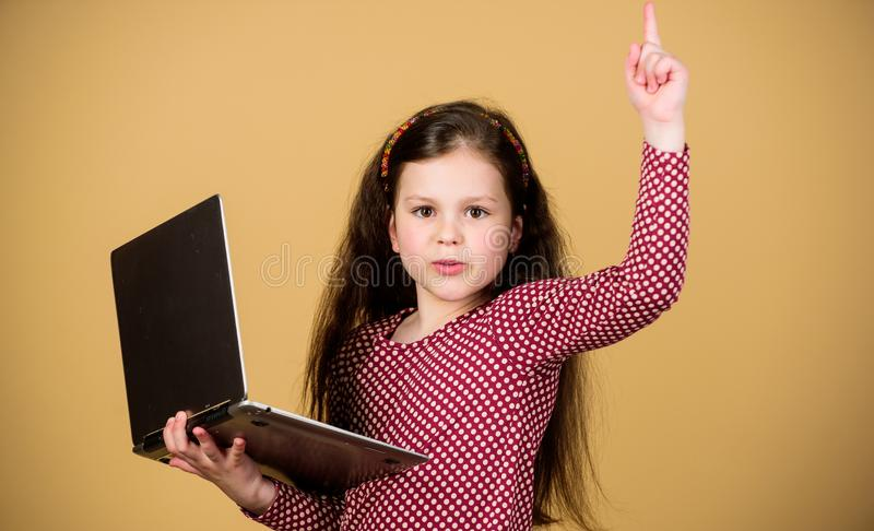 Information source. Blogging concept. Girl with laptop computer. Little child using pc. Digital technology. Life online. Surfing internet. Develop own blog royalty free stock photos