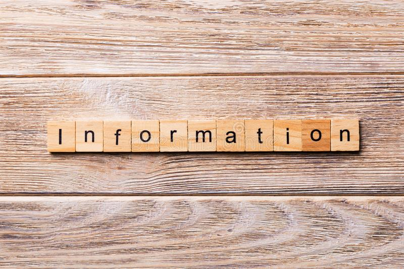 Information word written on wood block. Information text on wooden table for your desing, concept royalty free stock photography