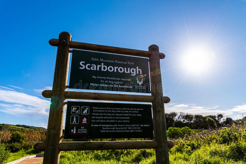 Informational sign at Scarborough beach in Cape Town, South Africa. An information sign in the Table Mountain National Park, listing allowed and prohibited stock photography