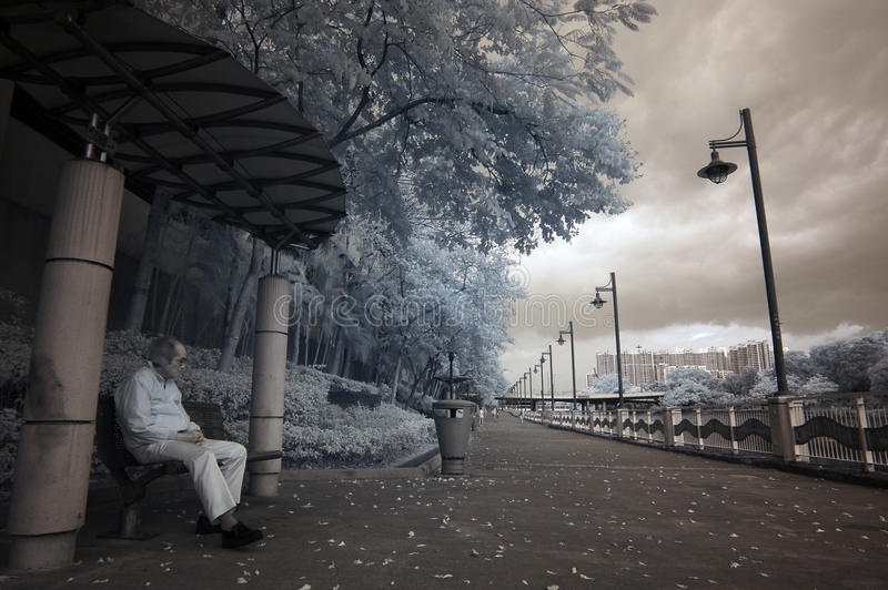 Infrared city. With old man seating royalty free stock photography