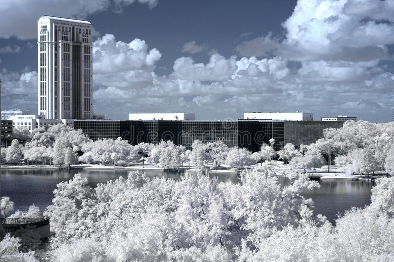 Infrared Downtown Orlando. Infrared shot of downtown Orlando, Florida facing the north side of Lake Eola. Office buildings and the courthouse appear in the shot stock photo
