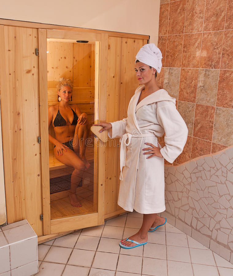 Infrared sauna. A infrared sauna cabin with two womens royalty free stock photo