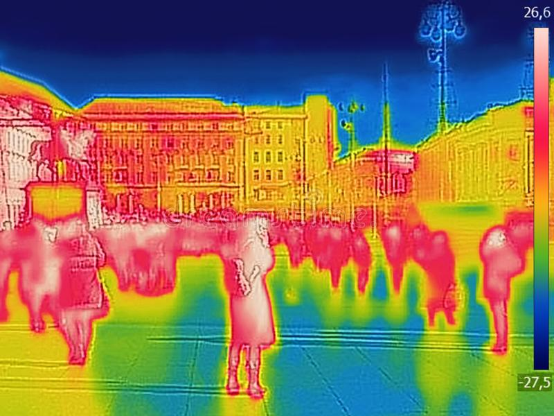 Infrared Thermal image of people walking the city streets on a cold winter day. Infrared Thermal image of people walking the city streets, on a cold winter day royalty free stock photography