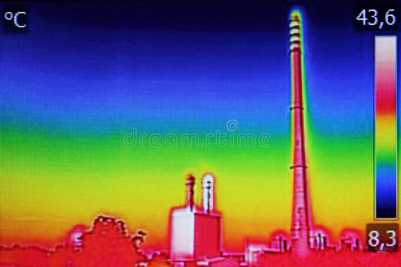 Infrared thermography image showing the heat emission at the Chi. Mney of energy station royalty free stock photography